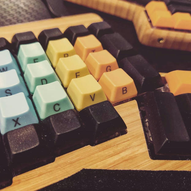 Photo shared by Coffee'n'Code on May 18, 2021 tagging @comment_sense, @kbwarriors, @falba.tech, @coderlifes, @mech.keyboards, @programunity, @keeb_click, @_devcommunity, and @the.teleport. May be an image of computer keyboard and indoor.